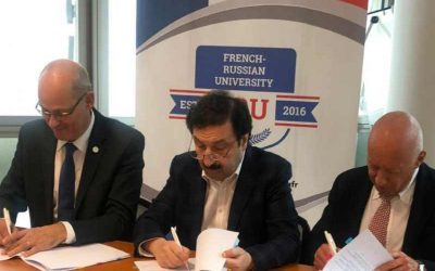 Vladimir Mau speaks at a conference on educational cooperation in France